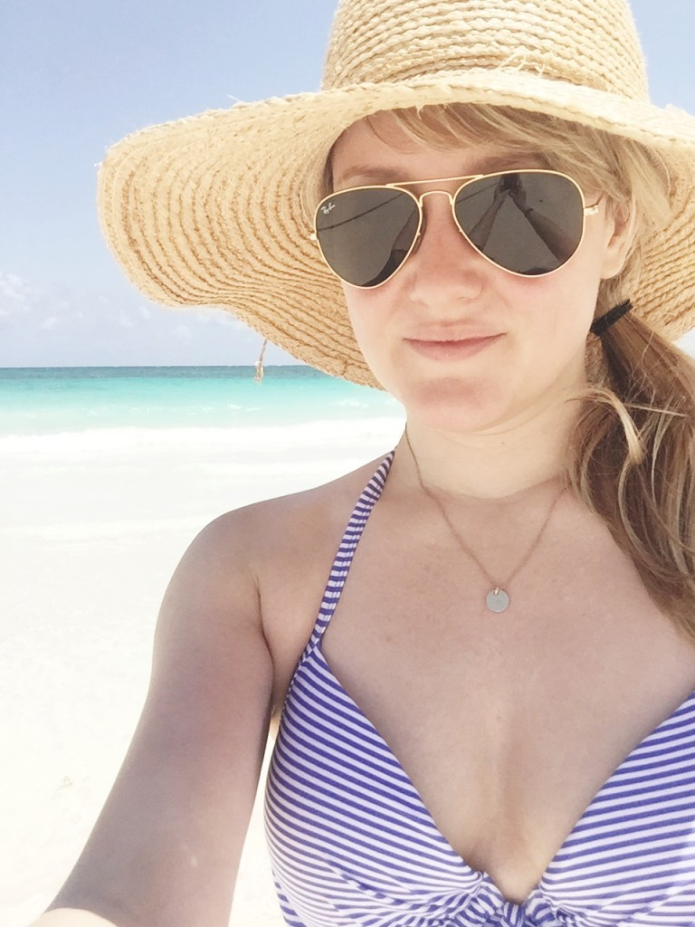 striped bathing suit and hat